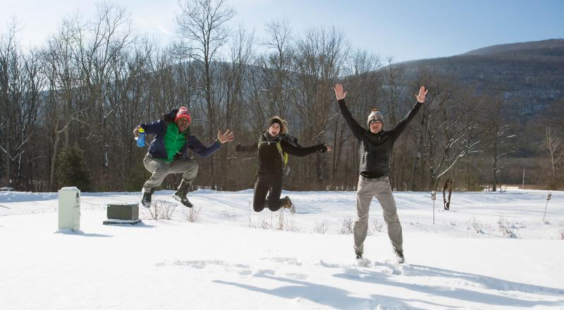 Winter hikers jumping for joy! Photo by Heather Phelps-Lipton.